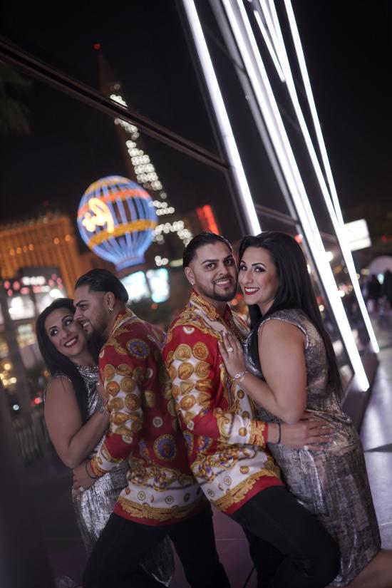 Man and woman pose on Las Vegas strip during proposal photo tour